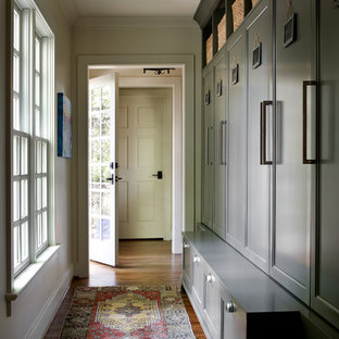 Entryway - mid-sized transitional medium tone wood floor and brown floor entryway idea in Atlanta with beige walls and a glass front door