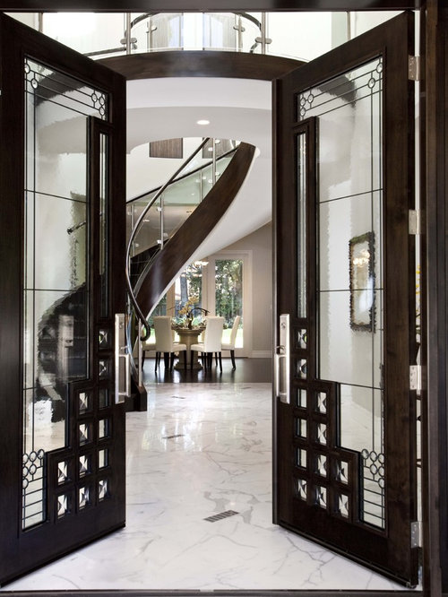 Ex&le of a trendy marble floor entryway design in San Francisco with white walls and a : iwp doors - pezcame.com