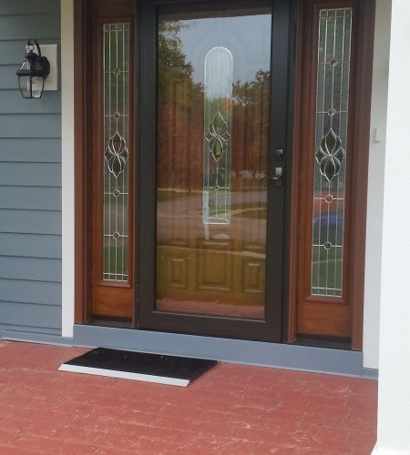 front door with storm door blue hardie plank siding