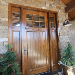 Inspiration for a large craftsman concrete floor entryway remodel in Denver with a medium wood front door
