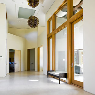 Trendy travertine floor and white floor entryway photo in San Francisco with white walls