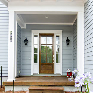 Beach style entryway photo in Jacksonville with gray walls and a medium wood front door