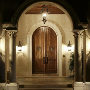 Entryway - mediterranean entryway idea in Orlando with a medium wood front door