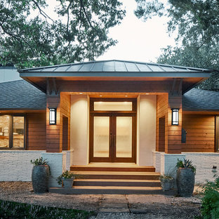 Inspiration for a large contemporary entryway remodel in Dallas with a glass front door