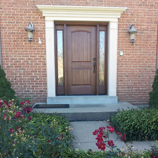 Southwest entryway photo in St Louis with a brown front door