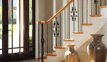 Front Entry Foyer Showing Staircase With Iron Railings