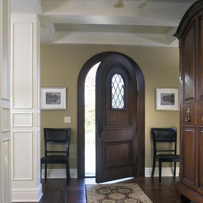 Large elegant dark wood floor single front door photo in Grand Rapids with beige walls and a dark wood front door