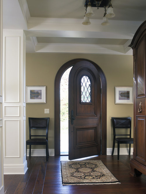 Large Elegant Dark Wood Floor Single Front Door Photo In Grand Rapids With  Beige Walls And