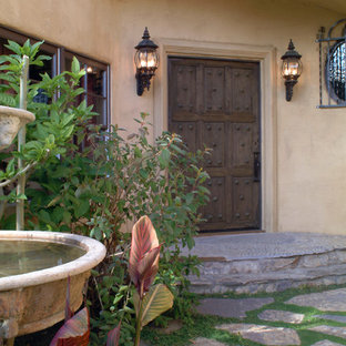Example of a tuscan entryway design in San Francisco with a dark wood front door