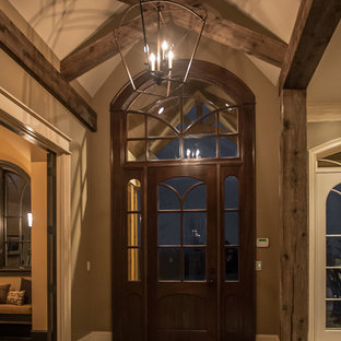 Inspiration for a large rustic slate floor foyer remodel in Louisville with brown walls and a dark wood front door