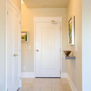 Entryway - small transitional granite floor and beige floor entryway idea in Ottawa with gray walls and a white front door
