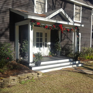 Entryway - small country entryway idea in Houston with a white front door