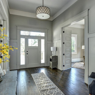 Large elegant entryway photo in Atlanta with gray walls and a gray front door