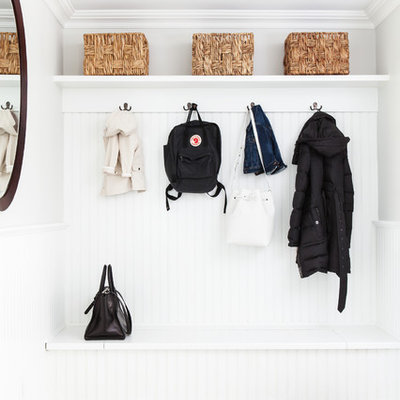 Inspiration for a transitional gray floor mudroom remodel in New York with gray walls
