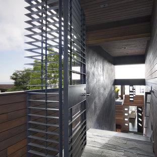 Entryway - modern entryway idea in San Francisco with a metal front door