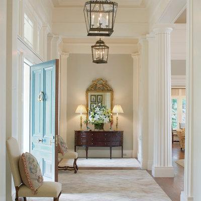 Elegant beige floor entryway photo in Atlanta with a blue front door