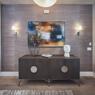 Inspiration for a mid-sized laminate floor and brown floor entryway remodel in Salt Lake City with purple walls and a black front door