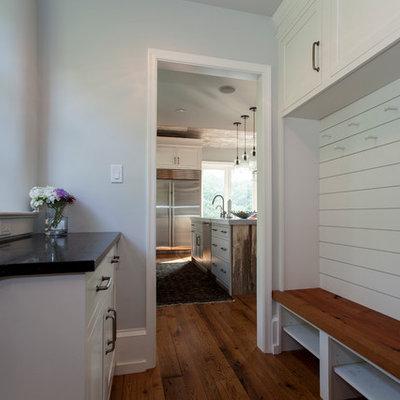 Mudroom - mid-sized country medium tone wood floor mudroom idea in Philadelphia with white walls