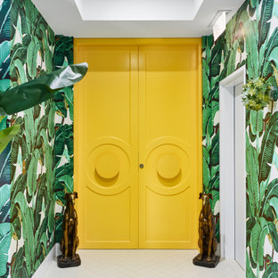 Design ideas for a contemporary foyer in Brisbane with green walls, a double front door, a yellow front door, white floor and wallpaper.