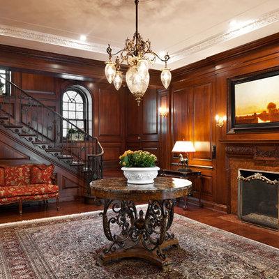 Elegant dark wood floor entryway photo in Montreal