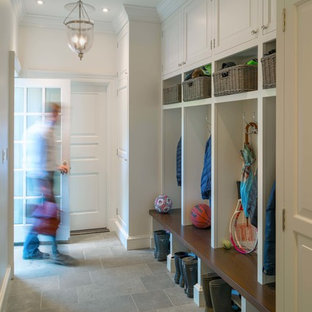 Entryway - large traditional slate floor and gray floor entryway idea in Boston with white walls and a white front door