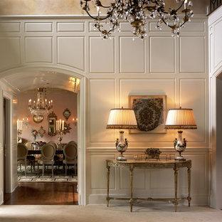 Elegant foyer photo in New York with beige walls
