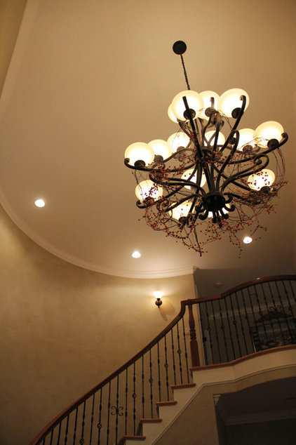 Traditional Entry Grapvine and Berry Garland in the Foyer Chandelier