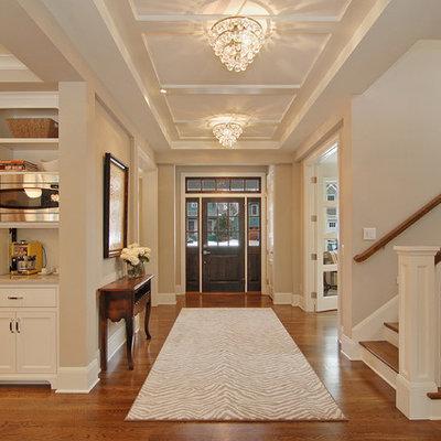 Elegant single front door photo in Minneapolis with beige walls and a dark wood front door
