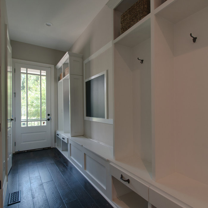 This second entry/vestibule to the home, was originally just an open hallway. By designing and incorporating  a customized cubby system for each family member, USI was able to create a space that enco
