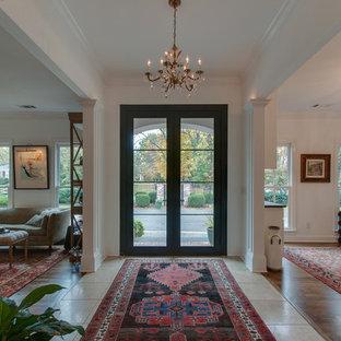 Ispirazione per un ingresso shabby-chic style di medie dimensioni con pareti bianche, pavimento in marmo, una porta a due ante, una porta nera e pavimento beige