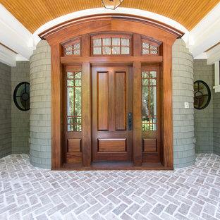 Elegant single front door photo in Charleston with a medium wood front door