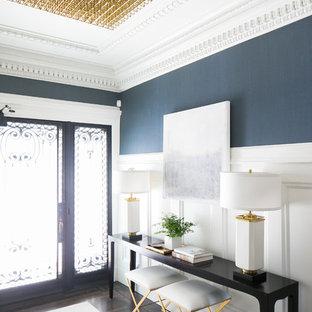 Foto de entrada clásica renovada con paredes azules, suelo de madera oscura, puerta simple y puerta de vidrio