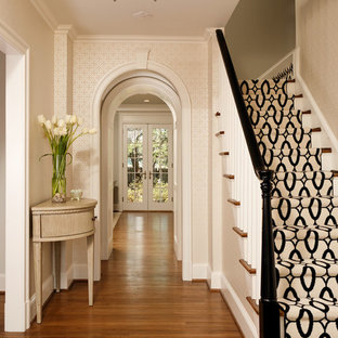 Inspiration for a timeless medium tone wood floor entryway remodel in DC Metro with beige walls