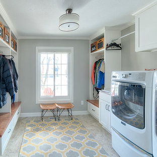 Mid-sized transitional porcelain floor entryway photo in Minneapolis with gray walls and a white front door