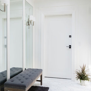 Inspiration for a small transitional marble floor and white floor entryway remodel in New York with white walls and a black front door