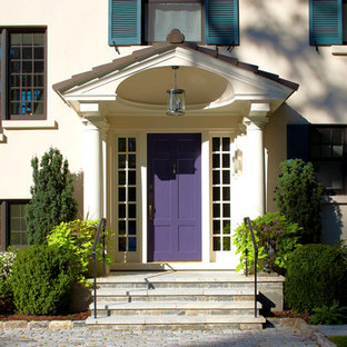 Example of a transitional entryway design in New York with beige walls and a purple front door