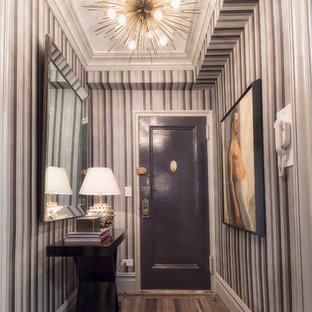 Entryway - transitional light wood floor entryway idea in New York