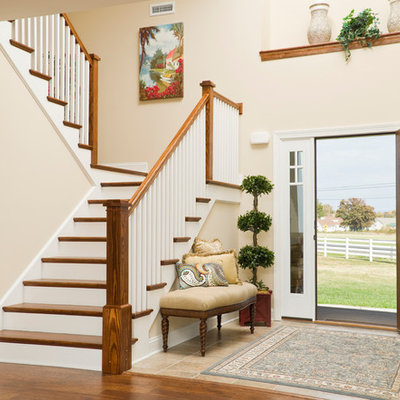 Entryway - mid-sized craftsman ceramic tile and beige floor entryway idea in Other with beige walls and a white front door