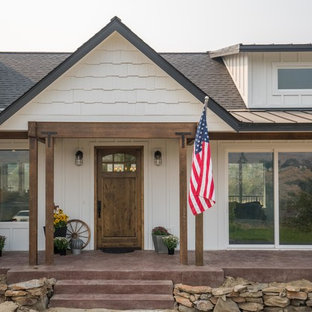 Example of a transitional entryway design in Seattle with a medium wood front door