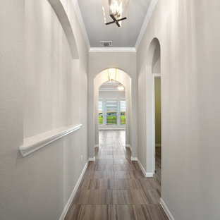Entryway - large transitional ceramic floor and gray floor entryway idea in Austin with gray walls and a white front door