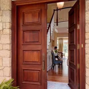Double front door - traditional double front door idea in New York with a dark wood front door
