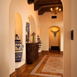 Entry hall - southwestern terra-cotta tile entry hall idea in Phoenix
