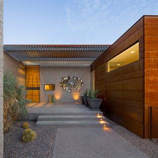 Minimalist entryway photo in Phoenix with a light wood front door