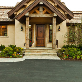 Inspiration for a rustic single front door remodel in Boise with a dark wood front door