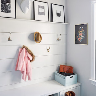 Example of a country mudroom design in Richmond with white walls