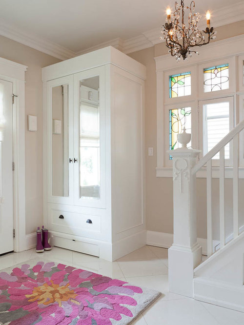 Amazing Example Of A Transitional Front Door Design In Toronto With Beige Walls