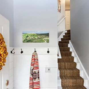 Example of a transitional painted wood floor and white floor entryway design in Chicago with gray walls