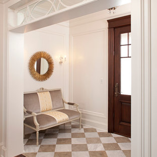 Elegant entryway photo in Minneapolis with white walls and a glass front door