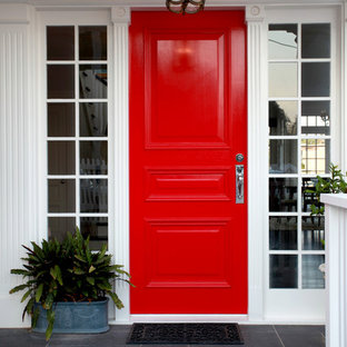 Mid-sized traditional entryway in Brisbane with a red front door.