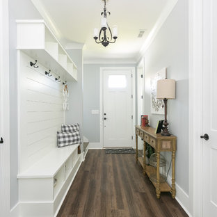 Example of a cottage dark wood floor and brown floor entryway design in Charleston with gray walls and a white front door